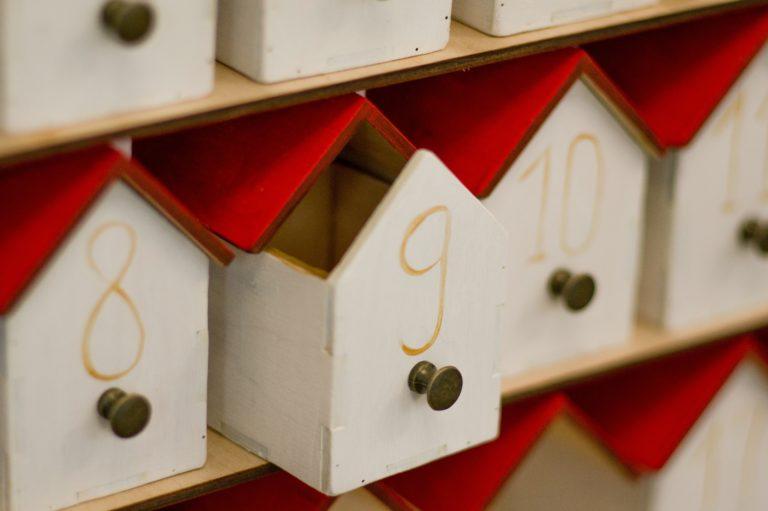 white numbered boxes with red roofs elena mozhvilo LJ5ZYYZAOWo unsplash